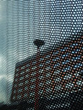 Black Mesh on Orange Building. Black Mesh with the Orange Building in the Background Royalty Free Stock Photography