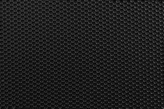 Black metal Background with Holes. Stock Photo
