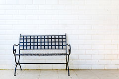 Black metal bench with white wall Royalty Free Stock Photography