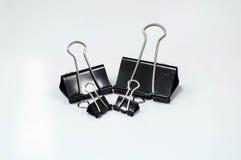 Black metal binder clips Stock Images