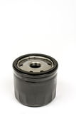 Black metal car oil filter isolated over white background Royalty Free Stock Photos