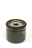Black metal car oil filter isolated over white background Royalty Free Stock Image