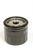 Black metal car oil filter isolated over white background Stock Images