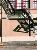 Black Metal Escape Ladder at Daytime stock image
