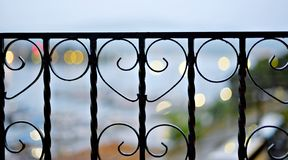 Black metal fence, decorative cast iron close-up stock images