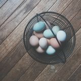 Black Metal Frame Basket With Eggs Stock Photo