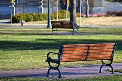 Black Metal Framed Brown Wooden Bench on Park Royalty Free Stock Photo