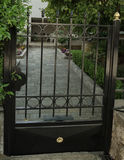 Black metal gate Stock Images