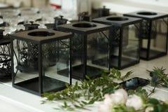 Black metal and glass Candle holder Event decor. Wedding banquet design stock photos