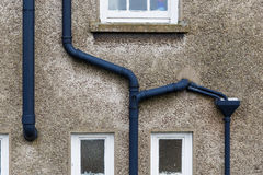 Black metal gutter. On the house wall Royalty Free Stock Photography