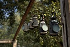 Black Metal Lanterns Hanged in Brown Wooden Frame Royalty Free Stock Photos