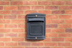 Black metal letter box on red brick wall Royalty Free Stock Photography