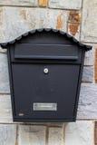 Black metal mailbox Stock Images