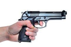 Black metal 9mm pistol gun in hand on white background Stock Photos