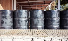Black metal oil barrels. In an outdoor storage space stock photo