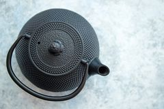 Black metal oriental teapot isolated stock image