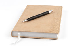 Black metal pen on diary beige Stock Photography