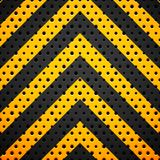 Black metal or plastic texture with holes Stock Images