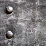 Black metal plate or armour texture with rivets Royalty Free Stock Photography