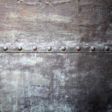 Black metal plate or armour texture with rivets Stock Images