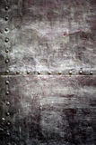 Black metal plate or armour texture with rivets Stock Photos