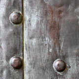 Black metal plate or armour texture with rivets Royalty Free Stock Photos