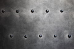 Black metal plate or armour texture with rivets Royalty Free Stock Image