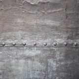 Black metal plate or armour texture with rivets Stock Photography