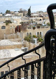 Black metal railing in front of Jerusalem Old City Jewish Quarter buildings and terraces. An ornate black staircase railing frames the Old City`s Jewish Quarter Royalty Free Stock Image