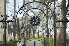 Black metal round residential fence Stock Images