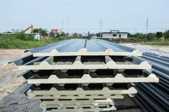 Black metal sheet roof with insulation attached under metal sheet. Construction royalty free stock photo