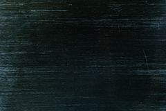 Black metal surface with many small scratches. Black metal surface with many small scratches royalty free stock images