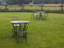 The black metal table and chair set in the garden. Royalty Free Stock Photography