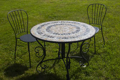 The black metal table and chair set in the garden for two person Stock Image