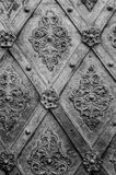 Black metal texture floral pattern background. Forging. Fasteners. The vertical frame Royalty Free Stock Photo