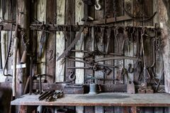 Black Metal Tools Hanged on a Rack Near Table Stock Photography
