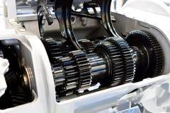 Black metallic gears. In a car motor Stock Images