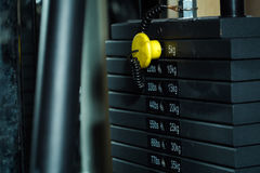 Black metallic or iron plates. Black metallic or iron heavy plates stacked for sport, exercise, weight machine with kilogram and pound numbers in fitness gym on Royalty Free Stock Photos