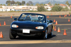 Black miata. Black japanese sports car competing in autocross race Stock Images