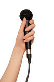 Black microphone. Woman holding a black microphone for singing Royalty Free Stock Image