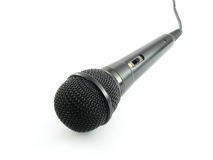 Black microphone. A black microphone isolated on a white background Royalty Free Stock Photography