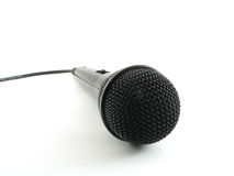 Black microphone. A black microphone isolated on a white background Stock Images