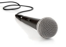 Black microphone with cable isolated Stock Image