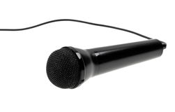 Black microphone with cable isolated over white Royalty Free Stock Images