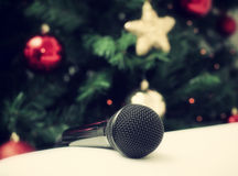 Black microphone with christmas tree Stock Photo