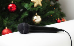 Black microphone with christmas tree Royalty Free Stock Photography