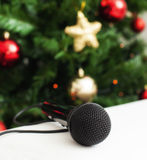 Black microphone with christmas tree Royalty Free Stock Images