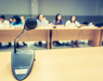 Black microphone in conference room ( Filtered image processed v Royalty Free Stock Images