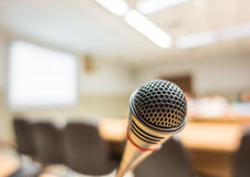 Black microphone in conference room ( Filtered image processed v Stock Images