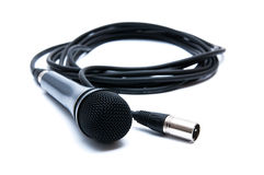 Black microphone with a cord on a white background Stock Photos